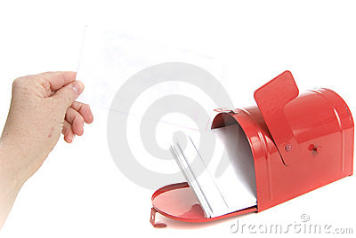 Hand holds a Bill in the mail