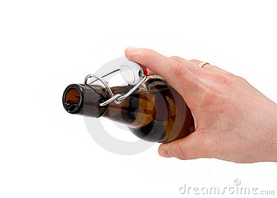Hand holds a bottle of beer.