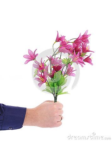 Hand holds bouquet of flowers.