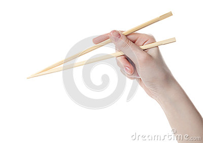 Hand holds the chopsticks