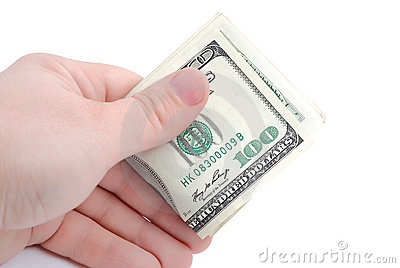 The hand holds dollars on white