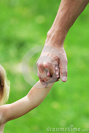 Hand holds the hand a parent child