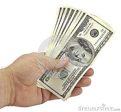 Hand holds the hundred-dollar bills