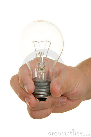 Hand holds incandescent lamp