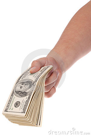 Hand holds a pack hundred dollar banknotes