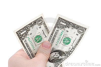 The hand holds two dollars