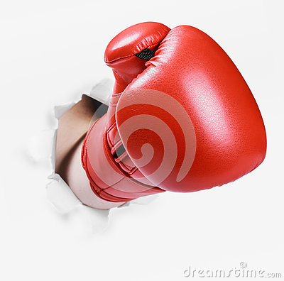 Free Hand In A Red Boxing Glove Broke Through The Paper Wall Royalty Free Stock Photo - 75011925