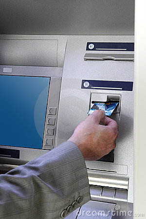 Free Hand Inserting Card Into Cash Dispense Stock Photo - 7972360