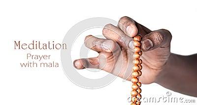 Hand with japa mala beads