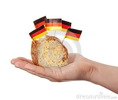 Hand keep cake with germany flags.