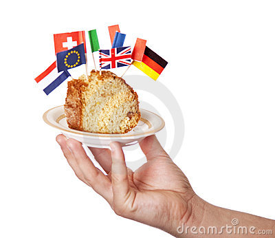 Hand keep cake with some european flags.