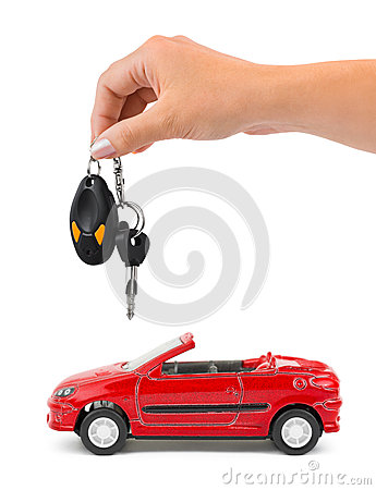 Hand with keys and car