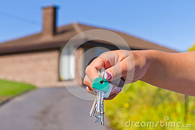 Hand with keys to new house