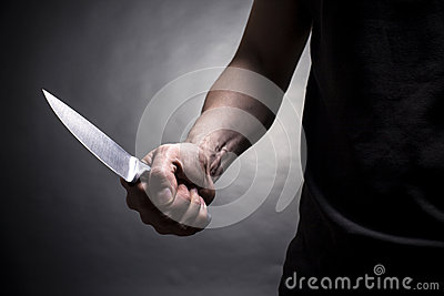 Hand with a knife