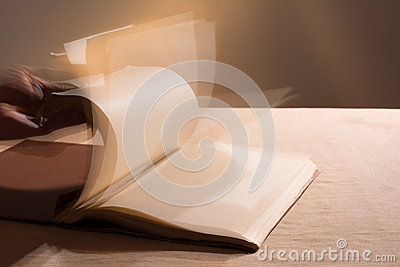 Hand leafing through the blank pages of the book