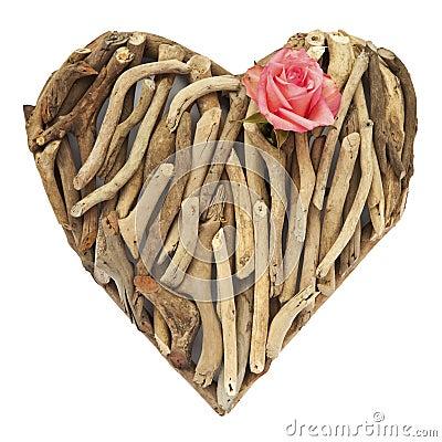 Hand-made ornamental heart made of dry sticks