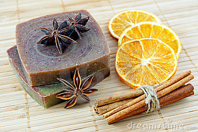 Hand-made soap with orange and cinnamon sticks