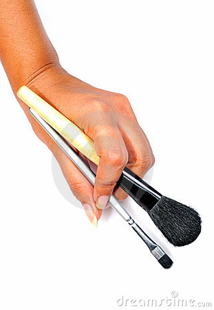 Hand with makeup brushes