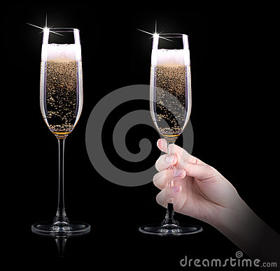 Hand making toast with champagne glass