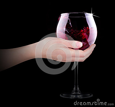 Hand making toast with wine