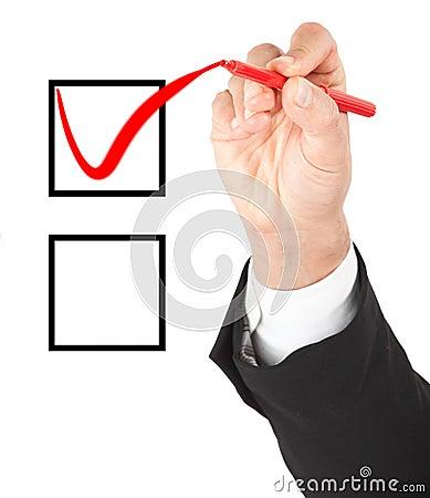 Hand marking one option Stock Photo