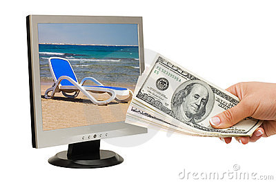 Hand with money and the monitor