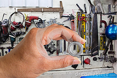 Hand with Nuts and Bolts