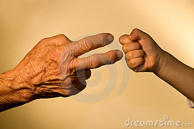 Hand of old woaman and child by game