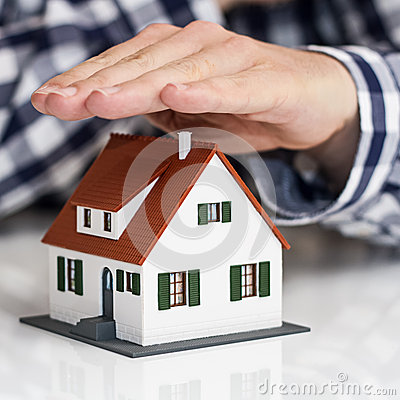 Free Hand Over Mini House Stock Images - 31525224