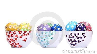 Hand painted easter eggs in ceramic bowls