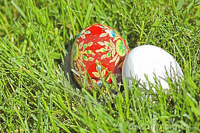 Hand painted ethnic egg and a white egg
