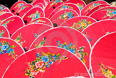 Hand painted pink umbrellas in Thailand