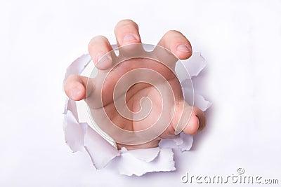 Hand through paper