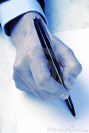 Hand and pen, close up