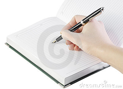 Hand with pen writes in notebook