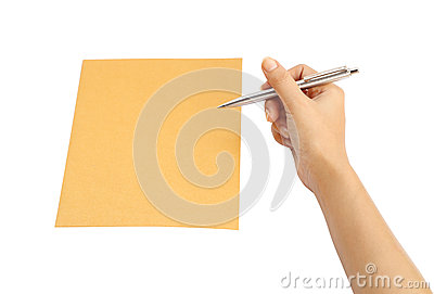 Hand with pen writing on the envelope
