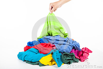 Hand pick up  shirt in pile of clothes