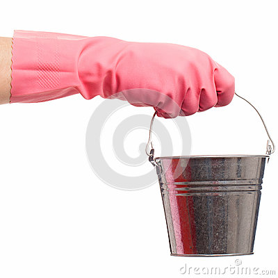 Hand in a pink glove holding silver pail