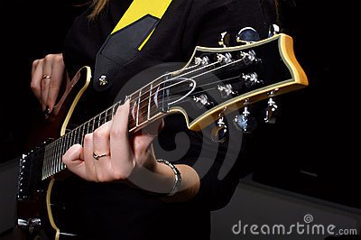 Hand play on guitar strings