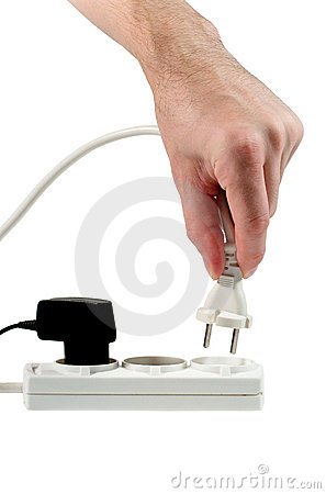 Hand with a plug to be plugged into an outlet