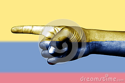 Hand point with finger in Colombia national flag