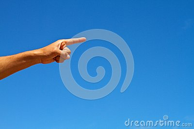 Hand Pointing against blue sky