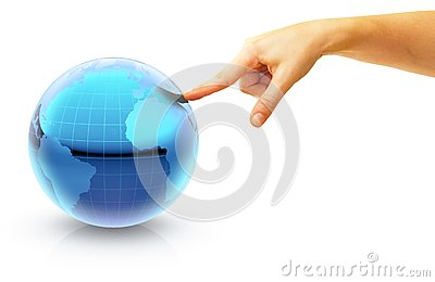 Hand pointing on a globe to Europe