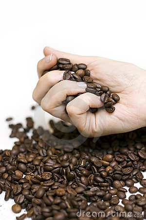 Hand pouring coffee beans