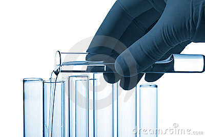 Hand pouring liquid into test tube isolated