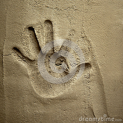 Hand print on cement mortar wall