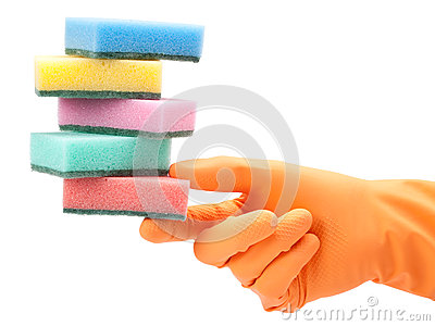 Hand in protective glove with washing sponge