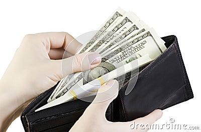 Hand pulling dollars