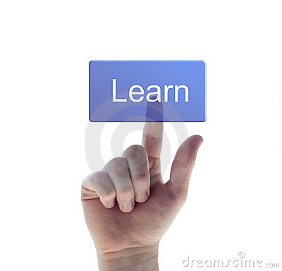Hand pushing the learn button
