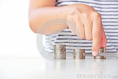 Hand put coin to stack